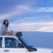 Mixed Race woman sitting on top of truck — 图库照片