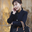 Asian woman talking on cell phone — Stok fotoğraf