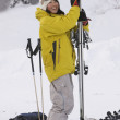 Asian woman holding skis — ストック写真