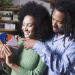 African couple looking at paint swatches — Foto Stock