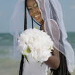 African bride holding bouquet — Stock Photo