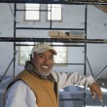 Hispanic man leaning on scaffolding — Stock Photo #23316228
