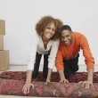 Stock Photo: Africcouple rolling rug
