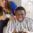Stock Photo: Africcouple playing video games