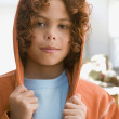 Mixed Race boy wearing hooded sweatshirt — Stock Photo