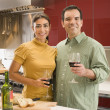 Multi-ethnic couple drinking wine — Stock Photo