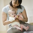 Asian mother playing with baby — Stock Photo