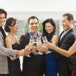 Stock Photo: Multi-ethnic couples toasting with champagne