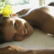 Hispanic woman laying on spa table — Stock Photo