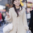 Asian woman in urban scene — Stock Photo