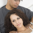Hispanic man massaging wife's shoulders — Stock Photo