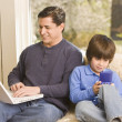 Hispanic father and son relaxing — Stock Photo