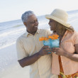 African couple walking on beach — Stock Photo