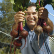 Stock Photo: Hispanic mholding organic produce