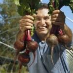 Hispanic man holding organic produce — Stock Photo