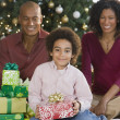 African family with Christmas gifts — Stock Photo