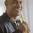 Stock Photo: African man drinking beer