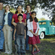 Multi-ethnic family in front of truck — Stock Photo