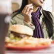 Asian woman behind diner food — Stock Photo
