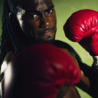 African male boxer punching — Stock Photo