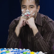 Asian man with birthday cake on face — Foto Stock