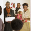 African family arriving with Christmas gifts — Stock Photo