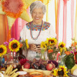 Senior Hispanic woman behind buffet table — Stock Photo
