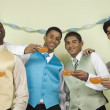 Stock Photo: Multi-ethnic men in suits holding cups of punch