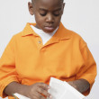 Stock Photo: African boy reading book
