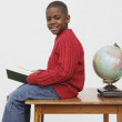 African boy reading book — Stock Photo