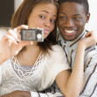African couple taking own photograph — Stock Photo
