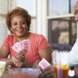 Senior African couple playing cards — Stock Photo