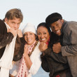 Multi-ethnic couples hugging — Stock Photo