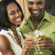 African couple toasting with cocktails — Foto Stock