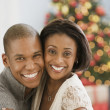 Mixed Race couple hugging on Christmas — Stock Photo