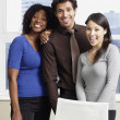 Multi-ethnic businesspeople in front of window — Stock Photo