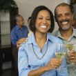 African couple toasting with drinks — Stok fotoğraf