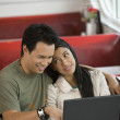 Asian couple using laptop — Stock Photo