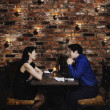 Asian couple eating at restaurant — Stock Photo #23317924