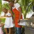 Mixed Race family barbecuing — Stock Photo