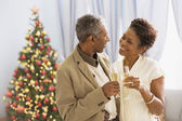African couple drinking champagne — Stock Photo