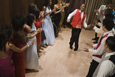 Multi-ethnic teenagers dancing at prom — Stock Photo