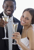 African newlyweds toasting with champagne — Stock Photo