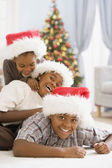 African siblings wearing Santa Claus hats — Stock Photo