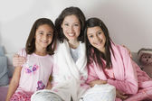 Hispanic mother and daughters in pajamas — Stock Photo