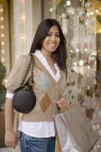 Indian woman holding shopping bags — Stock Photo