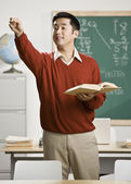 Asian male teacher calling on student — Stock Photo