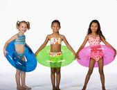 Multi-ethnic girls wearing bathing suits — Stock Photo