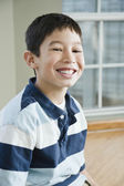 Close up of Mixed Race boy smiling — Stock Photo