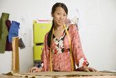 Asian female fashion designer in workshop — Stock Photo